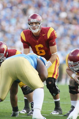 PASADENA, CA - DECEMBER 6:  Mark Sanchez #6 of the USC Trojans stands under center against the UCLA Bruins on December 6, 2008 at the Rose Bowl in Pasadena, California.  USC won 28-7.  (Photo by Jeff Golden/Getty Images)