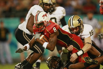 ORLANDO, FL - DECEMBER 29:  Wide receiver Darrius Heyward-Bey #8 of the Maryland Terrapins stretches for yardage against safety Brandon Erwin #16 of the Purdue Boilermakers in the Champs Sports Bowl at Florida Citrus Bowl on December 29, 2006 in Orlando,