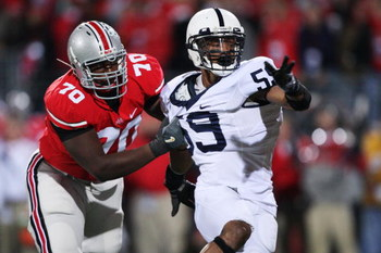 COLUMBUS, OH - OCTOBER 25: Offensive lineman Bryant Browning #70 of the Ohio State Buckeyes holds onto defensive lineman Aaron Maybin #59 of the Penn State Nittany Lions on October 25, 2008 at Ohio Stadium in Columbus, Ohio. No penalty was called on the p