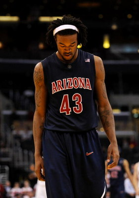 LOS ANGELES, CA - MARCH 12:  Forward Jordan Hill #43 of the Arizona Wildcats walks on the court during the final moments of their 68-56 loss to the Arizona State Sun Devils during the Pacific Life Pac-10 Men's Basketball Tournament at the Staples Center o