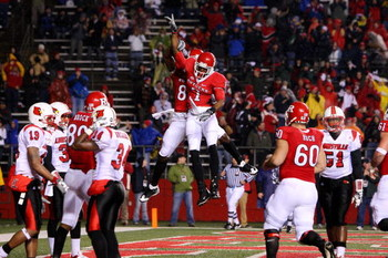 PISCATAWAY, NJ - DECEMBER 04:  Tiquan Underwood #7 of the Rutgers Scarlet Knights celebrates his touchdown in the first quarter with teammate Kenny Britt #88 against the Louisville Cardinals at Rutgers Stadium on December 4, 2008 in Piscataway, New Jersey