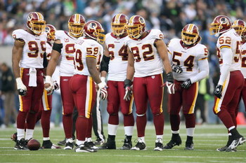 SEATTLE - NOVEMBER 23: London Fletcher #59 of the Washington Redskins leads the huddle during the game against the Seattle Seahawks on November 23, 2008 at Qwest Field in Seattle, Washington. (Photo by Otto Greule Jr/Getty Images)
