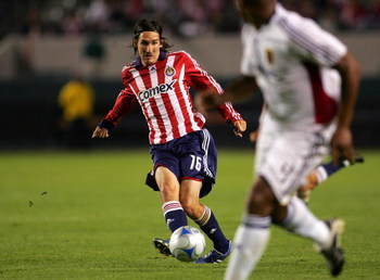 CARSON, CA - NOVEMBER 08:  Sacha Kljestan #16 of CD Chivas USA passes the ball on the attack in the first half during the second leg of their MLS playoff match against Real Salt Lake at The Home Depot Center on November 8, 2008 in Carson, California. Real