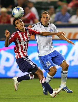 CARSON, CA - AUGUST 23:  Jonathan Bornstein #13 of CD Chivas USA looks to head the ball clear from Darren Huckerby #6 of San Jose Earthquakes in the first half during their MLS match at The Home Depot Center on August 23, 2008 in Carson, California.  (Pho