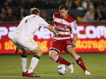 CARSON, CA - APRIL 12:  Ty Harden #3 of the Los Angeles Galaxy defends Kenny Cooper #33 of FC Dallas during their MLS match at The Home Depot Center on April 12, 2007 in Carson, California. FC Dallas defeated the Galaxy 2-1. (Photo by Jeff Gross/Getty Ima