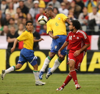SEATTLE - MAY 31:  Gilberto #6 of Brazil heads the ball against Dwayne De Rosario #14 of Canada on May 31, 2008 at Qwest Field in Seattle, Washington. Brazil defeated Canada 3-2. (Photo by Otto Greule Jr/Getty Images)