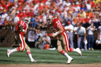 SAN FRANCISCO - OCTOBER 18:  Linebacker Tom Cousineau #59 of the San Francisco 49ers intercepts a pass along side teammate Kevin Dean #57 during a game against the St. Louis Cardinal at Candlestick Park on October 18, 1987 in San Francisco, California.  T