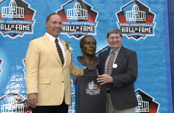 CANTON, OH - AUGUST 3:  Pro Football Hall of Fame inductee Joe DeLamielleure (L) poses with his bust and his presenter, sportswriter Larry Felser during the 2003 NFL Hall of Fame Induction ceremony on August 3, 2003 in Canton, Ohio.  (Photo by David Maxwe