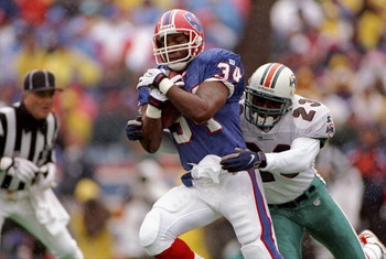 2 Nov 1997:  Running back Thurman Thomas #34 of the Buffalo Bills is tackled by defensive back George Teague #23 of the Miami Dolphins during the Bills 9-6 win at Rich Stadium in Orchard Park, New York. Mandatory Credit: Rick Stewart  /Allsport