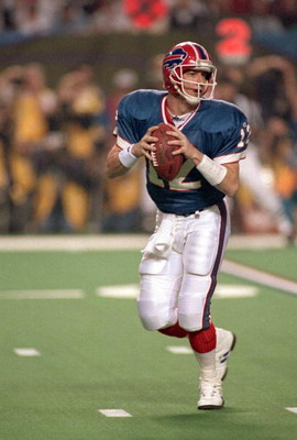 ATLANTA  - JANUARY 30:  Quarterback Jim Kelly #12 of the Buffalo Bills looks to pass during Super Bowl XXVIII against the Dallas Cowboys at the Georgia Dome on January 30, 1994 in Atlanta, Georgia.  Kelly completed 31-50 for 260 yards and 1 INT in a loosi