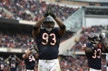 CHICAGO - DECEMBER 30:  Adewale Ogunleye #93, CHarles Tillman #33 and Brian Urlacher #54 of the Chicago Bears signal a safety after Ogunleye recorded one against the New Orleans Saints at Soldier Field on December 30, 2007 in Chicago, Illinois. The Bears