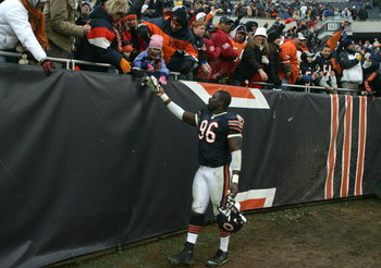 CHICAGO - DECEMBER 30:  Alex Brown #96 of the Chicago Bears gives his gloves to a young fan after the Bears 33-25 win against the New Orleans Saints at Soldier Field on December 30, 2007 in Chicago, Illinois.  (Photo by Jonathan Daniel/Getty Images)