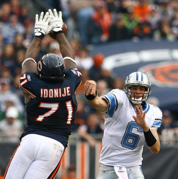CHICAGO - NOVEMBER 02:  Lineman Israel Idonije #71 of the Chicago Bears blocks a pass from quarterback Dan Orlovsky #6 of the Detroit Lions during the fourth quarter at Soldier Field on November 2, 2008 in Chicago, Illinois. The Bears defeated the Lions 2