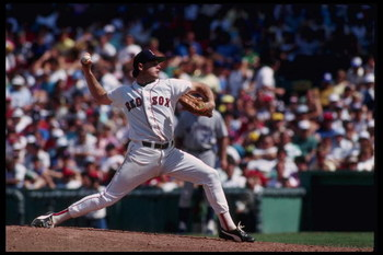 24 Dec 1996: Pitcher Roger Clemens of the Boston Red Sox winds up to throw a fast ball at Fenway Park in Boston, Massachusetts.