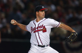 ATLANTA - OCTOBER 20:  Pitcher Greg Maddux #31 of the Atlanta Braves throws a pitch against the Arizona Diamondbacks on October 20, 2002 in the first inning of game four of the National League Championship Series at Turner Field in Atlanta, Georgia.  The