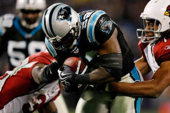 CHARLOTTE, NC - JANUARY 10:  Jon Beason #52 of the Carolina Panthers intercepts a pass against Larry Fitzgerald #11 and Edgerrin James #32 of the Arizona Cardinals during the NFC Divisional Playoff Game on January 10, 2009 at Bank of America Stadium in Ch