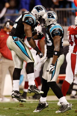 CHARLOTTE, NC - JANUARY 10:  (L-R) Jon Beason #52 and Chris Harris #43 of the Carolina Panthers celebrate a play during the game against the Arizona Cardinals during the NFC Divisional Playoff Game on January 10, 2009 at Bank of America Stadium in Charlot
