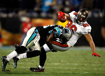 CHARLOTTE, NC - DECEMBER 08:  Jerramy Stevens #86 of the Tampa Bay Buccaneers is tackled by Richard Marshall #31 of the Carolina Panthers at Bank of America Stadium on December 8, 2008 in Charlotte, North Carolina.  (Photo by Streeter Lecka/Getty Images)