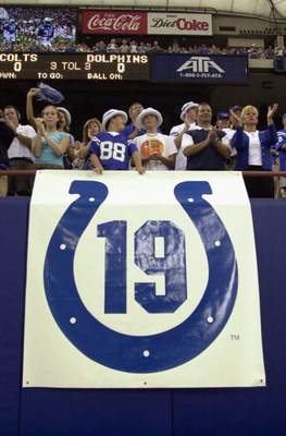 INDIANAPOLIS - SEPTEMBER 15:  Fans cheer above a banner in memory of former Baltimore Colts quarterback Johnny Unitas who passed away this past week before the Indianapolis Colts take on the Miami Dolphins on September 15, 2002 at the RCA Dome in Indianap