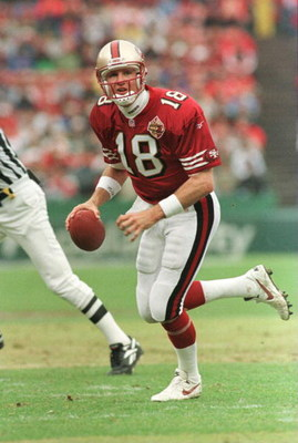 17 Nov 1996:  Quarterback Elvis Grbac of the San Francisco 49ers looks downfield while scrambling with the football during the first quarter versus the Baltimore Ravens at 3Com Park in San Francisco, California.  Mandatory Credit: Otto Greule/Allsport