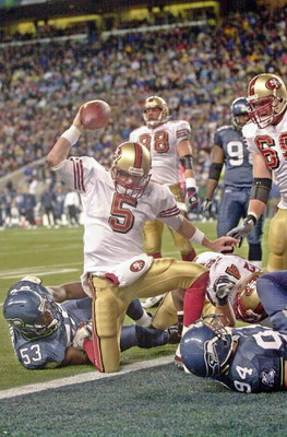 SEATTLE - OCTOBER 12:  Quarterback Jeff Garcia #5 of the San Francisco 49ers spikes the ball after scoring a touchdown against the Seattle Seahawks on October12, 2003 at Seahawks Stadium in Seattle, Washington.  (Photo by Otto Greule Jr/Getty Images)