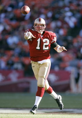 SAN FRANCISCO - AUGUST 13:  Quarterback Trent Dilfer #12 of the San Francisco 49ers tosses a pass in a pre-season game at Monster Park August 13, 2007 in San Francisco, California.  (Photo by Greg Trott/Getty Images)