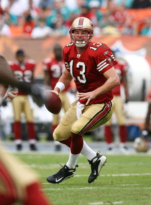 MIAMI - DECEMBER 14:  Quarterback Shaun Hill #13 of the San Francisco 49ers drops back to pass against the Miami Dolphins at Dolphin Stadium on December 14, 2008 in Miami, Florida. The Dolphins defeated the 49ers 14-9.  (Photo by Doug Benc/Getty Images)