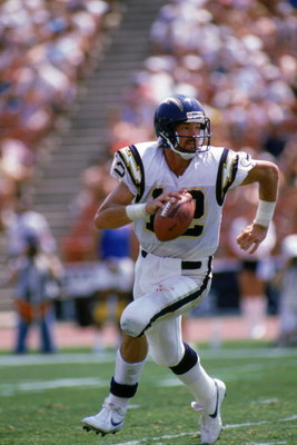 LOS ANGELES - SEPTEMBER 4:  Quarterback Babe Laufenberg #12 of the San Diego Chargers runs with the ball during a game against the Los Angeles Raiders at the Los Angeles Memorial Coliseum on September 4, 1988 in Los Angeles, California.  The Raiders won 2