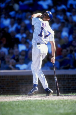 11 Sep 1998:  Mark Grace #17 of the Chicago Cubs lowers his bat as he looks at the fly ball during the game against the Milwaukee Brewers  at Wrigley Field in Chicago, Illinois. The Brewers defeated the Cubs 13-11.