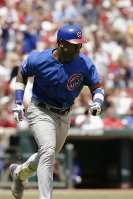 ST. LOUIS - JULY 10:  Sammy Sosa #21 of the Chicago Cubs runs during the game against the St. Louis Cardinals on July 10, 2004 at Busch Stadium in St. Louis, Missouri.  The Cardinals won 5-2.  (Photo by Elsa/Getty Images)