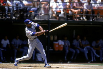 SAN DIEGO - 1990:  Andre Dawson #8 of the Chicago Cubs swings the bat during a game with the San Diego Padres in 1990 at Jack Murphy Stadium in San Diego, California.  (Photo by Stephen Dunn/Getty Images)