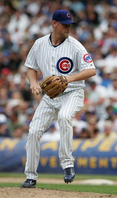 CHICAGO - JUNE 20: Closing pitcher Kerry Wood #34 of the Chicago Cubs delivers the ball in the 9th inning against the Chicago White Sox on June 20, 2008 at Wrigley Field in Chicago, Illinois. The Cubs defeated the White Sox 4-3. (Photo by Jonathan Daniel/