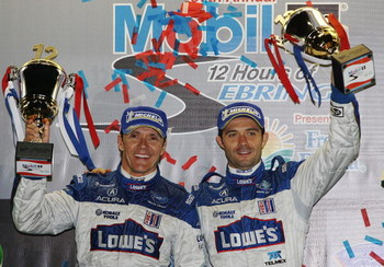 SEBRING, FL - MARCH 21:  Adrian Fernandez (L), and Luis Diaz of the #15 Lowe's Fernandez Racing Acura ARX-01B celebrate their victory in the LMP2 class during the 57th Annual Mobil1 12 Hours of Sebring at Sebring International Raceway on March 21, 2009 in