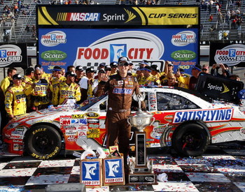 BRISTOL, TN - MARCH 22:  Kyle Busch, driver of the #18 Snickers Toyota, poses in victory lane after winning the NASCAR Sprint Cup Series Food City 500 at Bristol Motor Speedway on March 22, 2009 in Bristol, Tennessee.  (Photo by John Harrelson/Getty Image