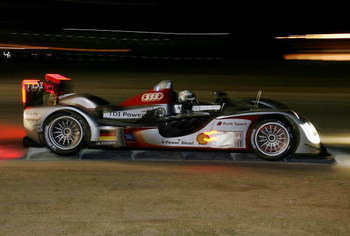 SEBRING, FL - MARCH 21:  Allan McNish driver of the #2 Audi Sport Team Joest Audi R15 TDI gets through turn seven during the 57th Annual Mobil1 12 Hours of Sebring at Sebring International Raceway on March 21, 2009 in Sebring, Florida.  (Photo by Doug Ben