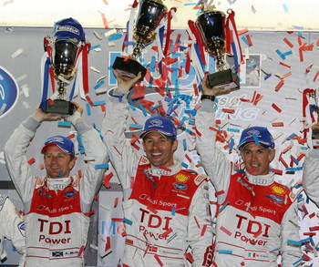 SEBRING, FL - MARCH 21:  (L-R) Allan McNish, Tom Kristensen and Rinaldo Capello of the #2 Audi Sport Team Joest Audi R15 TDI celebrate after their class and overall victory in the 57th Annual Mobil1 12 Hours of Sebring at Sebring International Raceway on