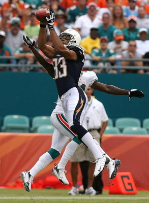 MIAMI - OCTOBER 05:  Wide receiver Vincent Jackson #83 of the San Diego Chargers grabs a reception over cornerback Andre Goodman #21 of the Miami Dolphins at Dolphin Stadium on October 5, 2008 in Miami, Florida. The Dolphins defeated the Chargers 17-10.