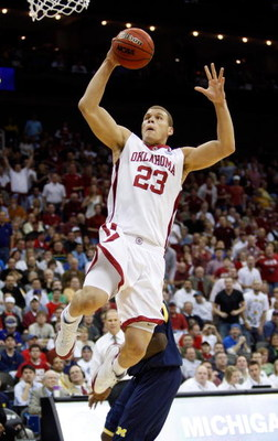KANSAS CITY, MO - MARCH 21:  Blake Griffin #23 of the Oklahoma Sooners jumps to the net for a lay up against the Michigan Wolverines during the second round of the NCAA Division I Men's Basketball Tournament at the Sprint Center on March 21, 2009 in Kansa