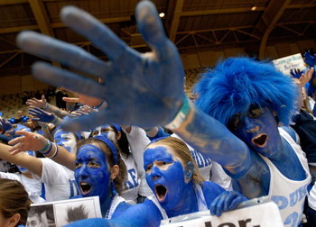 DURHAM, NC - FEBRUARY 07:  Fans cheer as they wait for the start of a game between the Duke Blue Devils and the North Carolina Tar Heels on February 7, 2007 at Cameron Indoor Stadium in Durham, North Carolina.  (Photo by Grant Halverson/Getty Images)