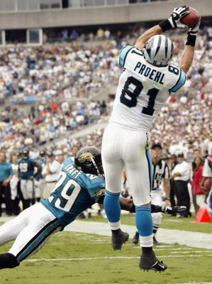 CHARLOTTE, NC - SEPTEMBER 7:  Jason Craft #29 of the Jacksonville Jaguars can't stop the winning touchdown catch by Ricky Proehl #81 of the Carolina Panthers on September 7, 2003 at Ericsson Stadium in Charlotte, North Carolina. The Panthers defeated the