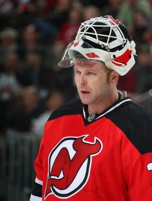 NEWARK, NJ - MARCH 20:  Martin Brodeur #30 of the New Jersey Devils takes a break in the action in his game against the Minnesota Wild on March 20, 2009 at the Prudential Center in Newark, New Jersey.  (Photo by Bruce Bennett/Getty Images)