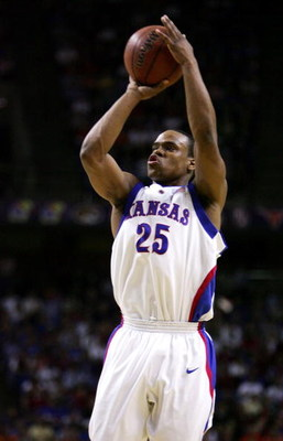 KANSAS CITY, MO - MARCH 12:  Michael Lee #25 of the Kansas Jayhawks shoots a jumper in the first half against the Oklahoma State Cowboys in the Semifinals of the Phillips 66 Big 12 Men's Basketball Tournament at Kemper Arena on March 12, 2005 in Kansas Ci