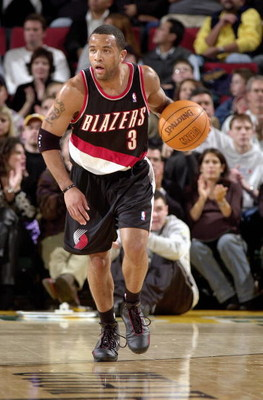 SEATTLE - NOVEMBER 7:  Damon Stoudamire #3 of the Portland Trail Blazers pushes the ball up court during the game against the Seattle Sonics in Key Arena on November 7, 2003 in Seattle, Washington.  The Sonics won 100-82.  NOTE TO USER: User expressly ack