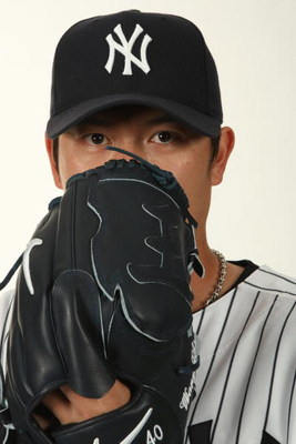 TAMPA, FL - FEBRUARY 19:  Chien-Ming Wang #40 of the New York Yankees poses during Photo Day on February 19, 2009 at Legends Field in Tampa, Florida. (Photo by Nick Laham/Getty Images)
