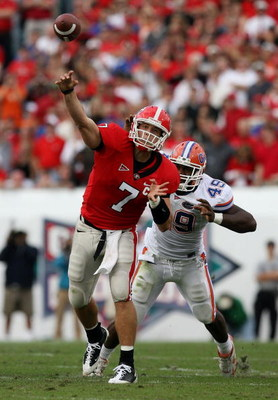 JACKSONVILLE, FL - NOVEMBER 01: Quarterback Matthew Stafford #7 of the Georgia Bulldogs throws a pass under pressure from defensive end Jermaine Cunningham #49 of the Florida Gators at Jacksonville Municipal Stadium on November 1, 2008 in Jacksonville, Fl