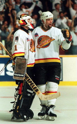11 JUN 1994: CANUCKS DEFENSEMAN BRENT HEDIGAN CELEBRATES WITH GOALTENDER KIRK MCLEAN AFTER DEFEATING THE RANGERS, 4-1, IN GAME SIX OF THE STANLEY CUP FINALS IN VANCOUVER, BRITISH COLUMBIA. THE WIN TIES THE SERIES AT 3-3. GAME SEVEN WILL BE PLAYED IN NEW Y