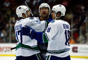 ANAHEIM, CA - OCTOBER 31:  (L-R) Ryan Kesler #17, Mattias Ohlund #2, and Steve Bernier #18 of the Vancouver Canucks celebrate Ohlund's goal in the second period against the Anaheim Ducks looks at the Honda Center on October 31, 2008 in Anaheim, California