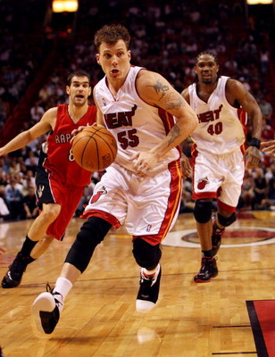 MIAMI - APRIL 03:  Jason Williams #55 of the Miami Heat drives to the basket after getting past Jose Calderon #8 of the Toronto Raptors at American Airlines Arena on April 3,  2007 in Miami, Florida. The Heat defeated the Raptors 92-89. NOTE TO USER: User