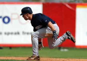 SARASOTA, FL - MARCH 1:  Outfielder Brett Gardner #11 of the New York Yankees over runs second base against the Cincinnati Reds March 1, 2009 at Ed Smith Stadium in Sarasota, Florida.  Gardner was tagged out.  (Photo by Al Messerschmidt/Getty Images)