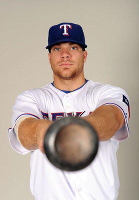 SURPRISE, AZ - FEBRUARY 24:  Chris Davis #19 of the Texas Rangers poses during photo day at Surprise Stadium on February 24, 2009 in Surprise, Arizona.  (Photo by Harry How/Getty Images)